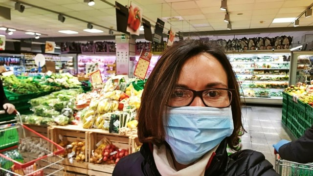 Dasha taking selfie in the supermarket full of goods