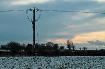 telegraph pole with snow