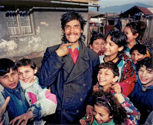A modern Romani man and children. Photography by Patrick Cariou. Image courtesy of RROMA.co.uk