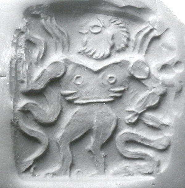 A stone seal found at the Gonur site. The motif of a man clutching two serpents is very common in Mesopotamian art.
