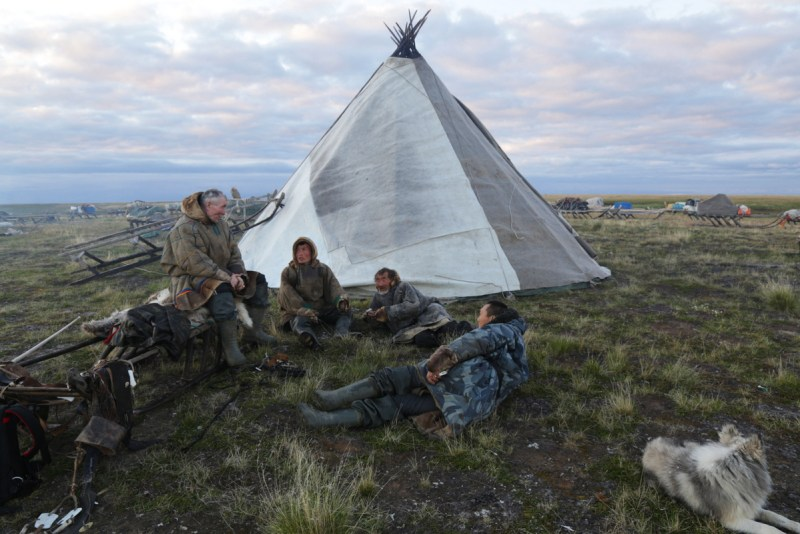 """Native American history: Nomadic people in modern Siberia, next to a house they call a """"chum."""""""
