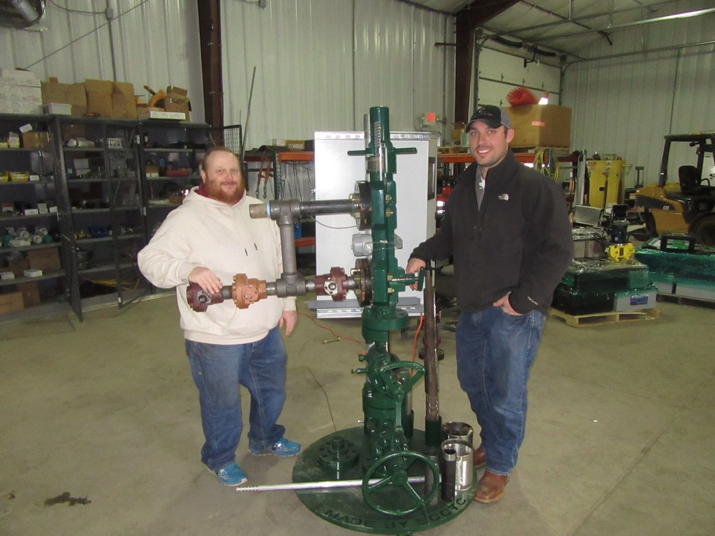 Cabot employees Adam Vogt, left, and Ryan Bennett
