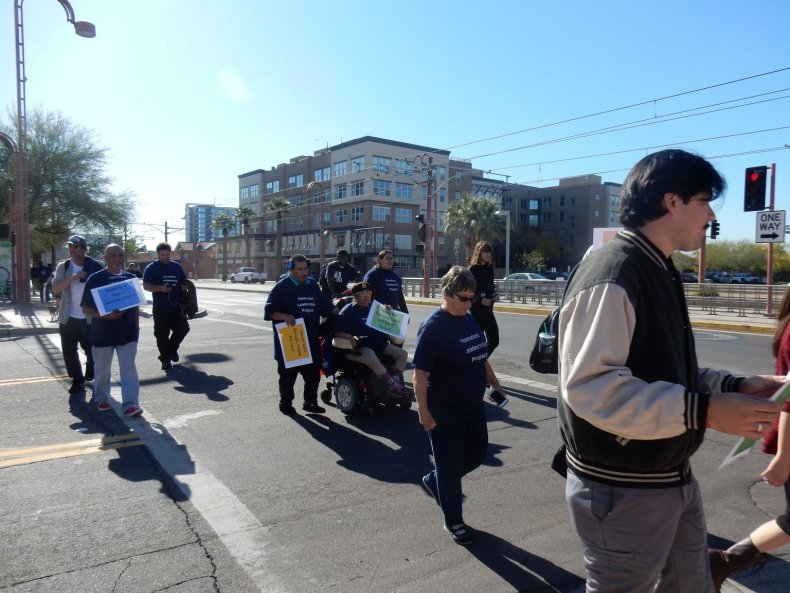 Protesters gather to march against the criminalization of Homelessness and poverty.