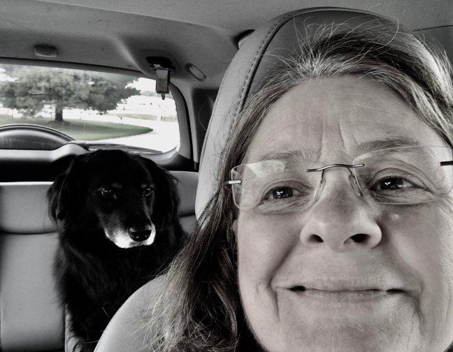 A lady and her dog take a selfie and decrease their stress.