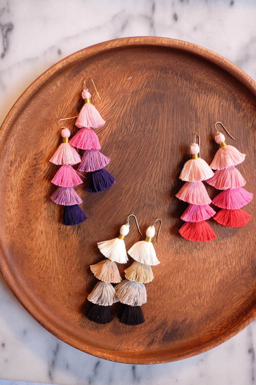 c14282bf24b454 diy tassel earrings // the stripe blog: easy tutorial to create layered  multicolor tassel