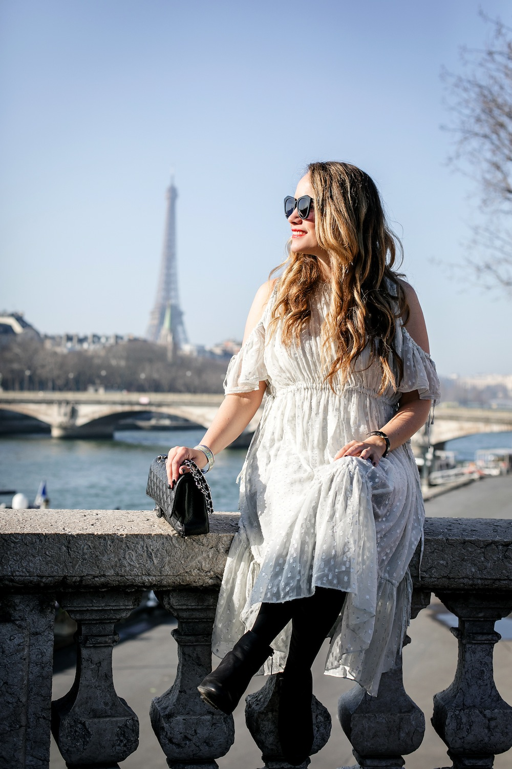 pont alexander iii bridge paris, with view of the Eiffel Tower | Grace Atwood, wearing Needle & Thread Lurex Chiffon Dress