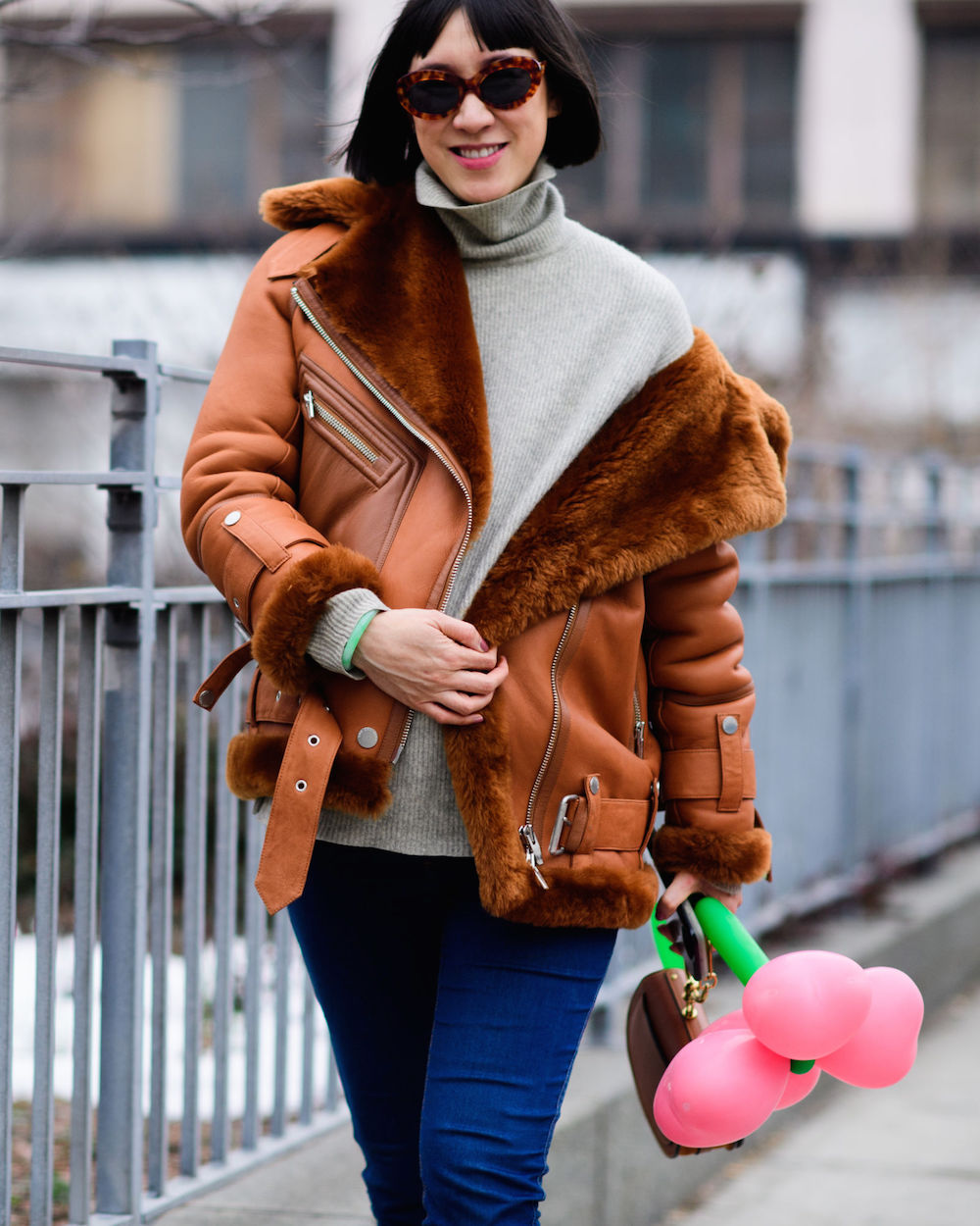 wearable street style nyfw fall 2017 // eva chen in a shearling jacket and tortoise sunnies | the stripe blog