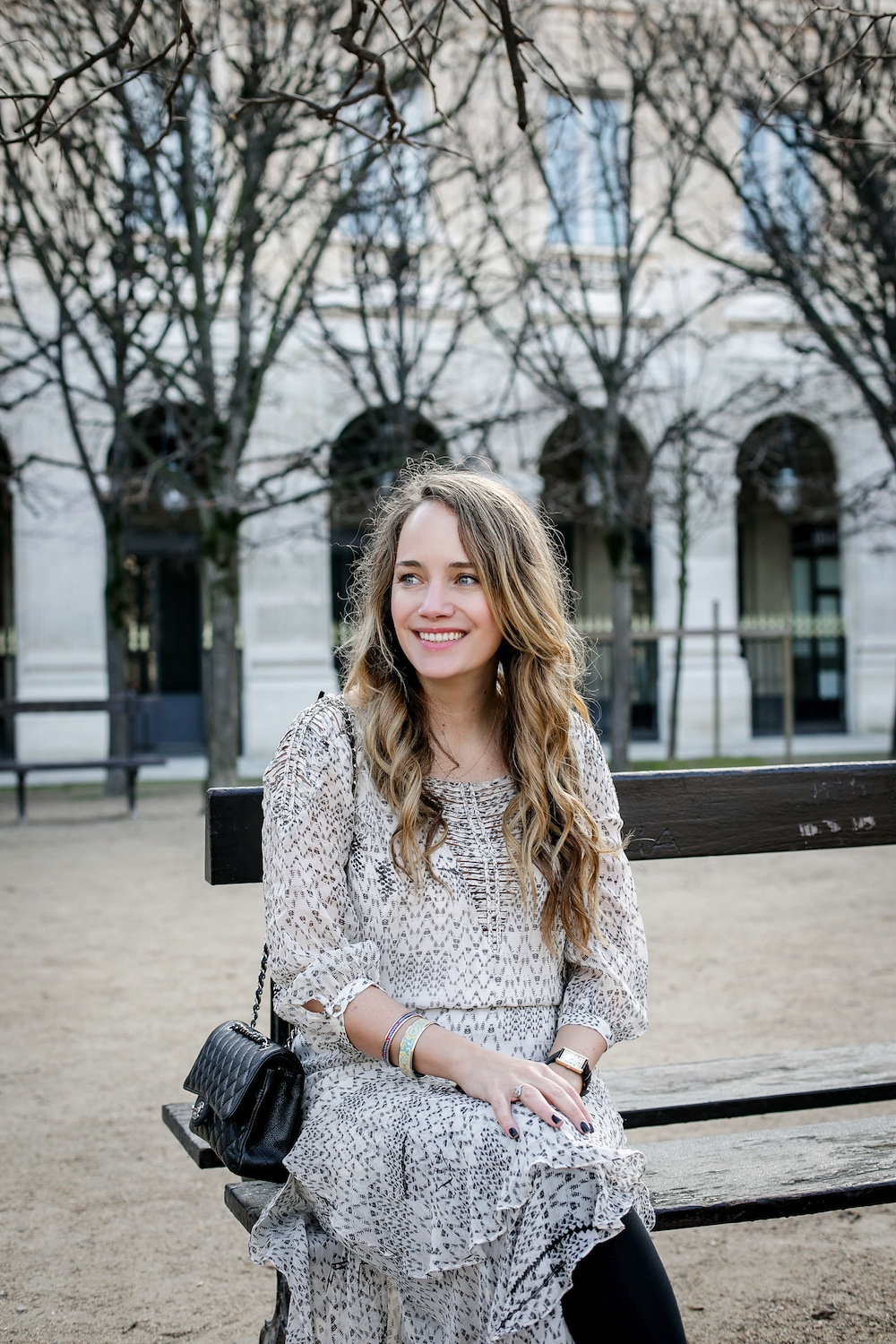 palais royal paris / grace atwood from the stripe wearing a cynthia vincent midi dress and hermes enamel bangle bracelets in paris.