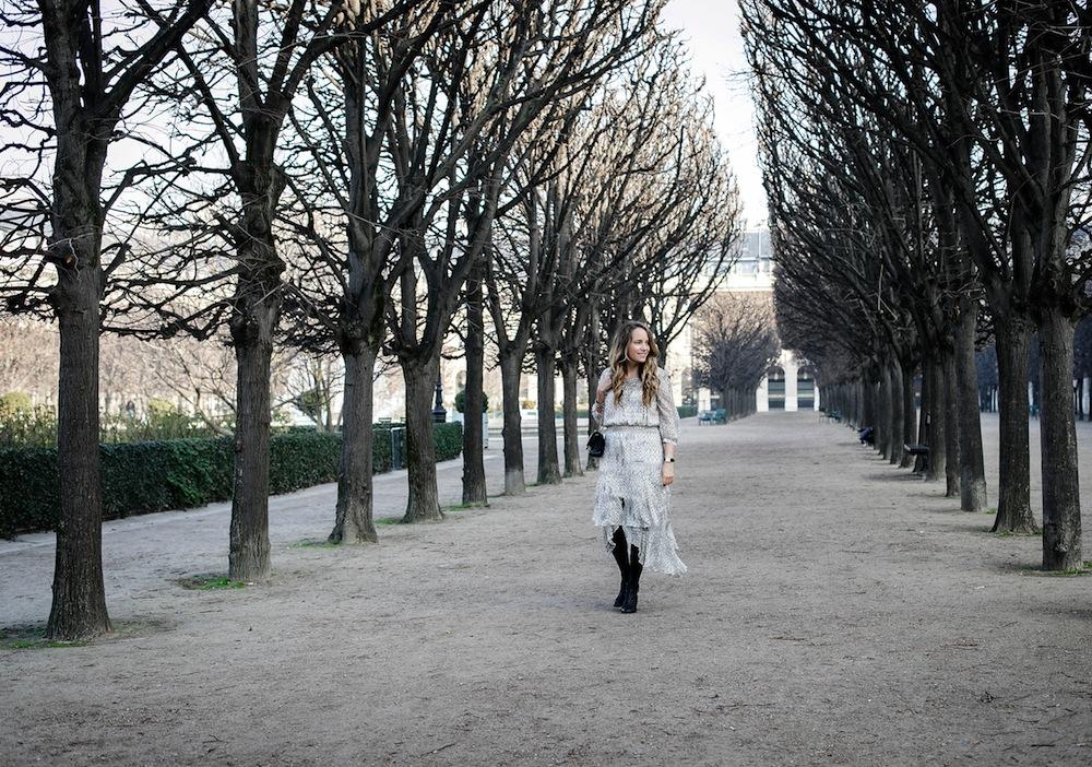 palais royal paris / grace atwood from the stripe wearing a cynthia vincent midi dress in paris.