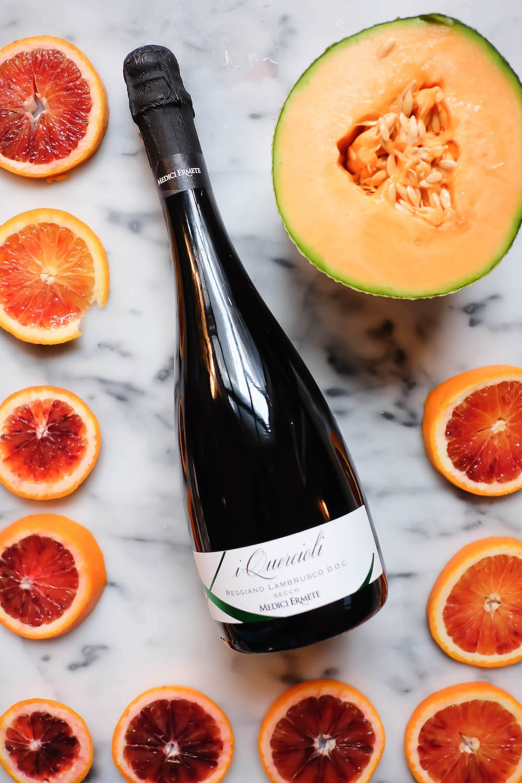 winter frosé recipe - ingredients: lambrusco wine, blood orange, cantaloupe   the stripe blog