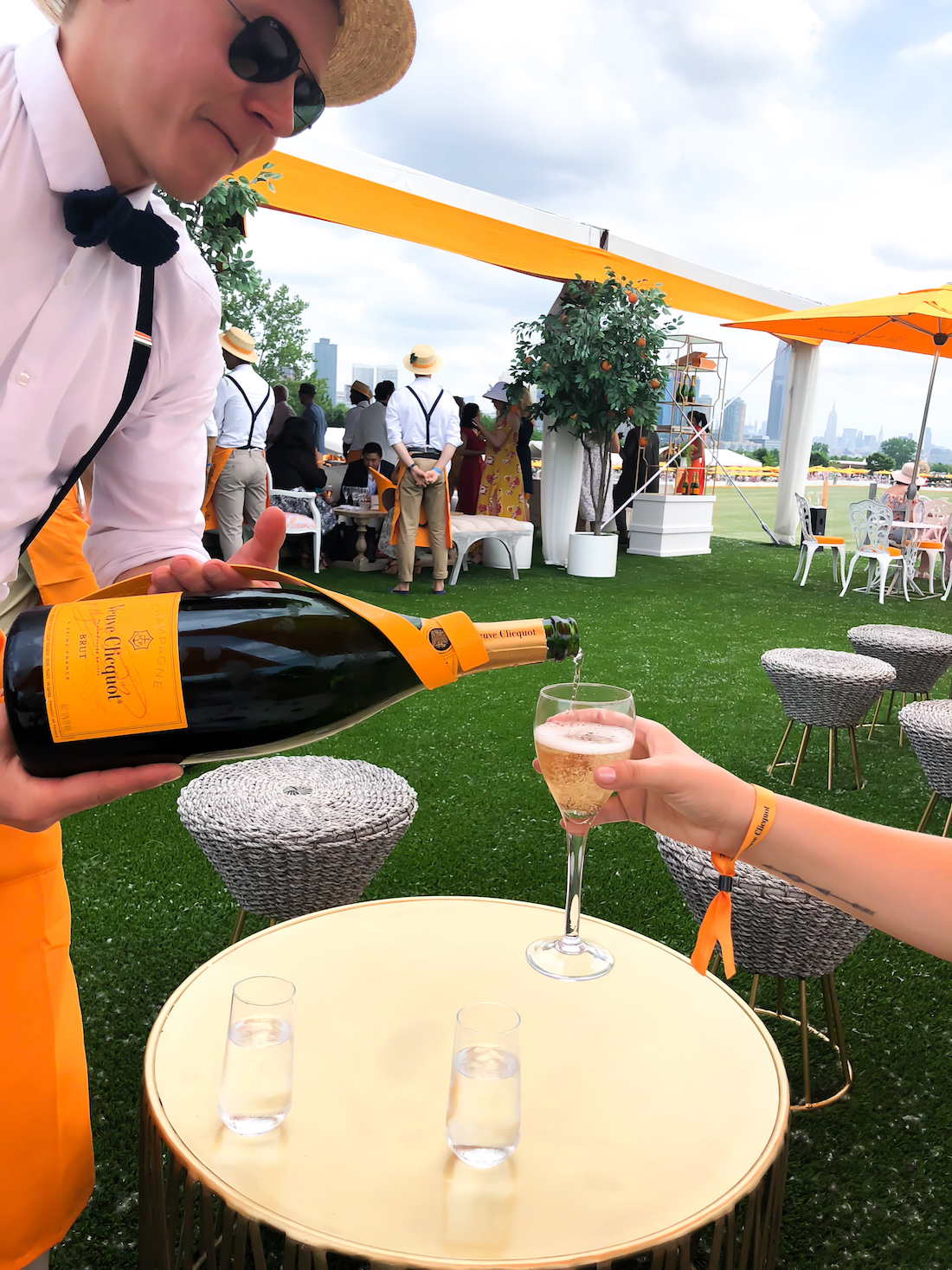 Serving champagne in the Veuve Clicquot Polo Classic 2018 - The Stripe