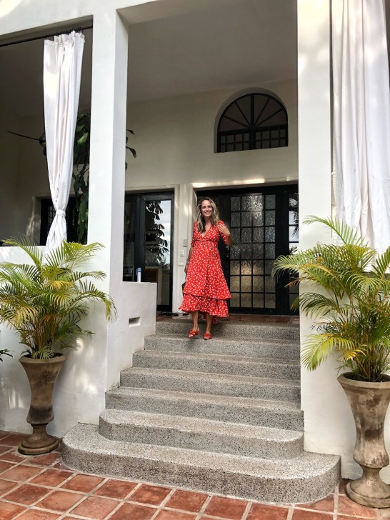 grace atwood of the stripe styles a ganni wrap dress in sayulita, mexico