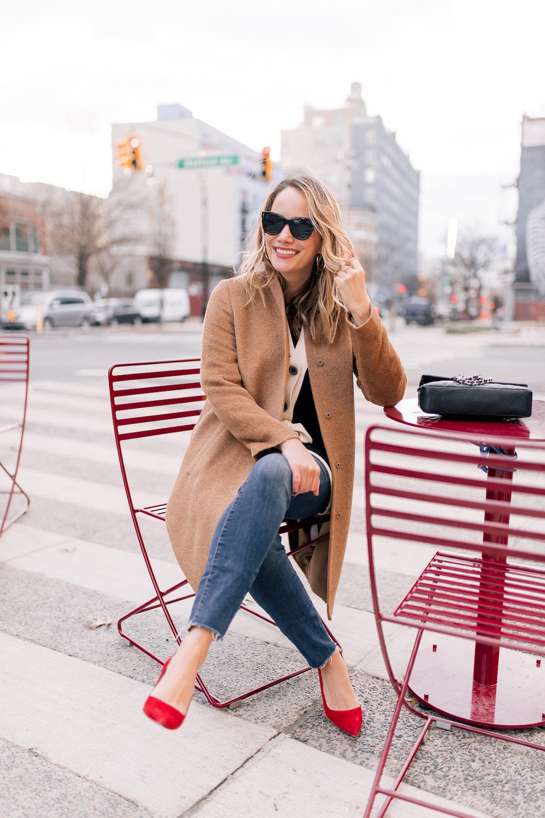 Grace Atwood Outfit Details:Eileen Fisher Coat // White & Warren Cardigan // Good American Jeans // Polaroid Sunglasses // Chanel Purse// Manolo Blahnik Heels