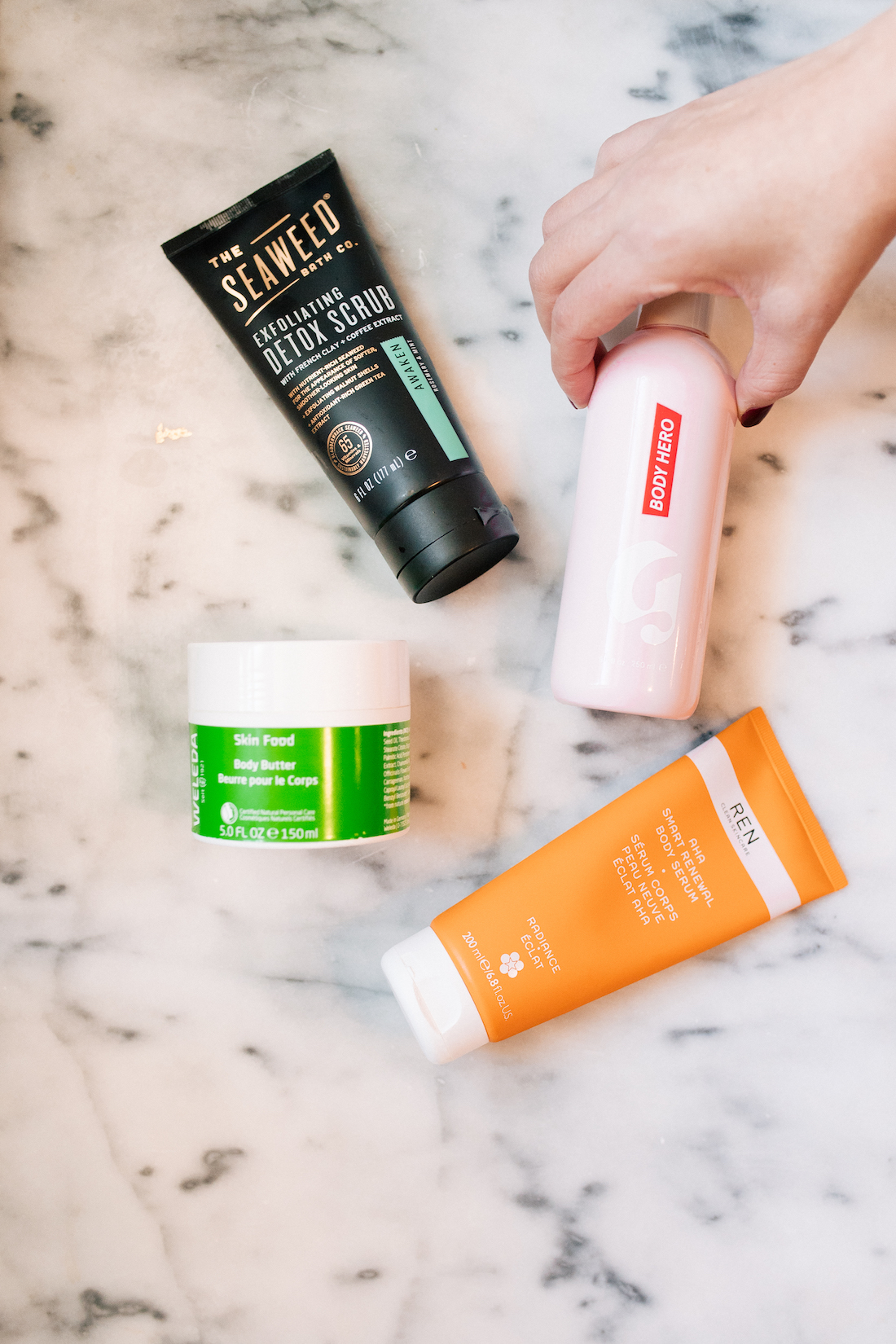 my favorite body products for dry skin | the best body wash, body scrub, body serum, and body butter! #beauty #skincare #beautyblogger #glossier | thestripe.com