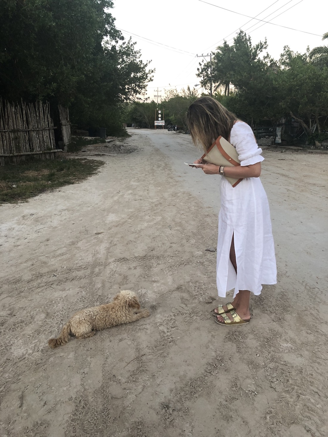 Grace is wearing a white maxi dress in Isla Holbox