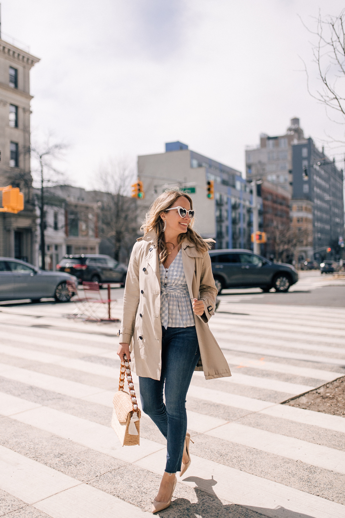 Grace Atwood's Outfit Details: Burberry Trench // Anthropologie Gingham Top // Good American Jeans // Manolo Blahnik Pumps // Pamela Munson Bag // Free People Sunglasses // Rachel Comey Earrings
