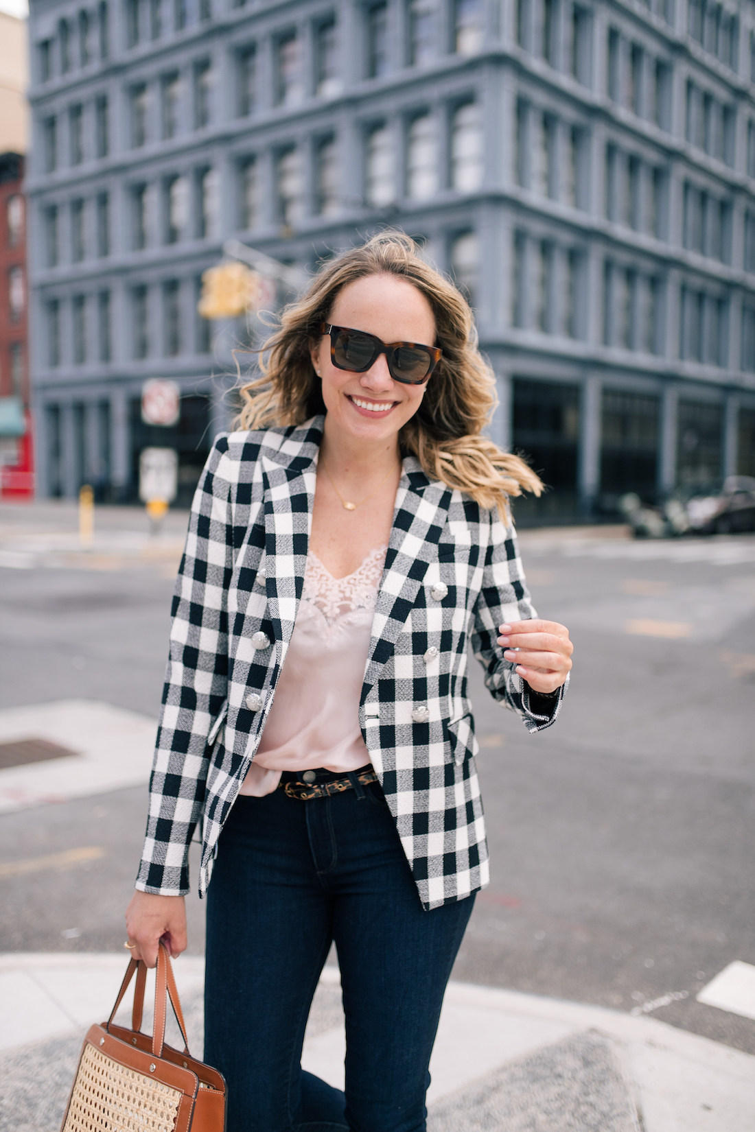 Grace is wearing a Veronica Beard Blazer,  Atlantic-Pacific x Halogen Camisole and Paige Jeans