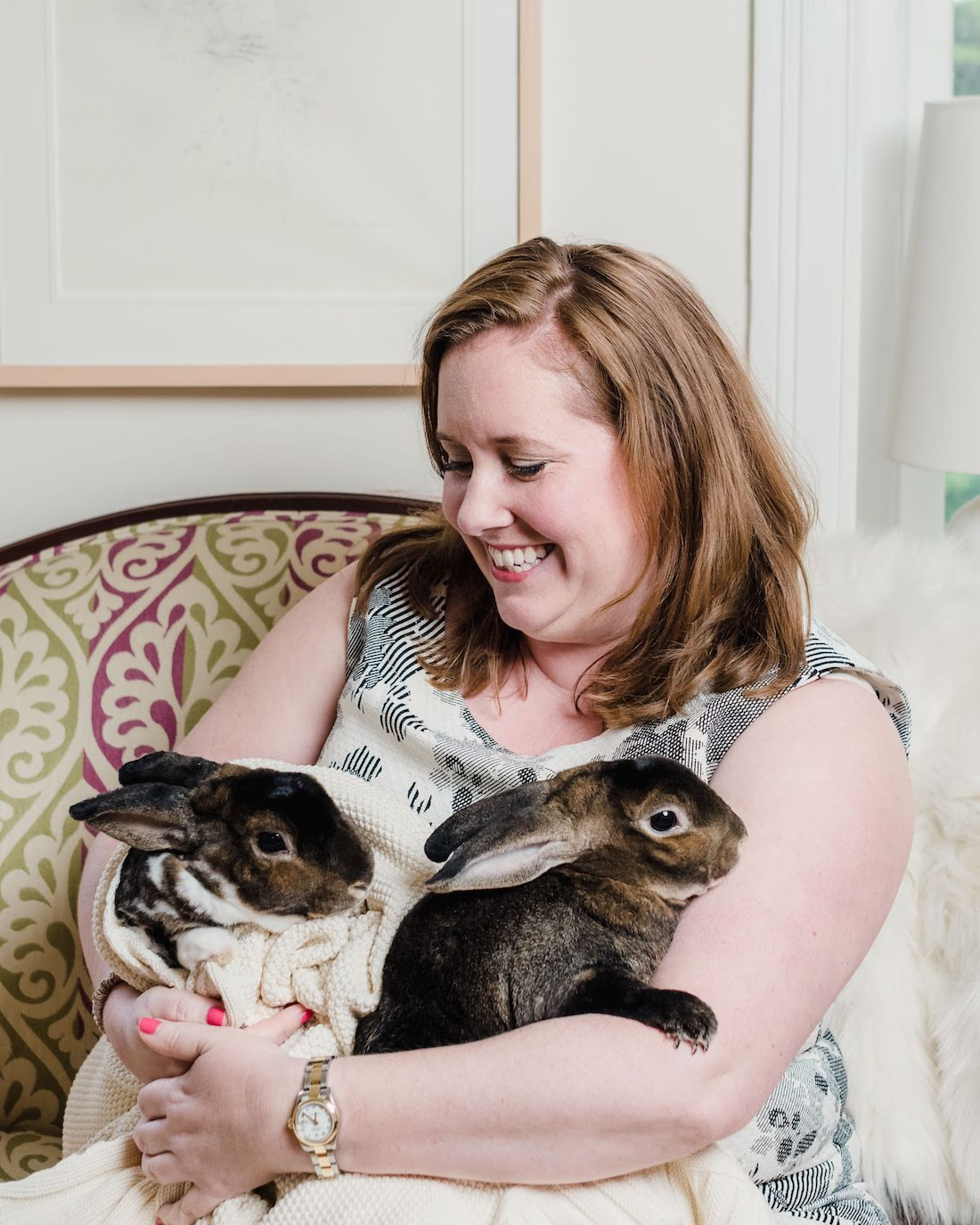woman is holding rabbits