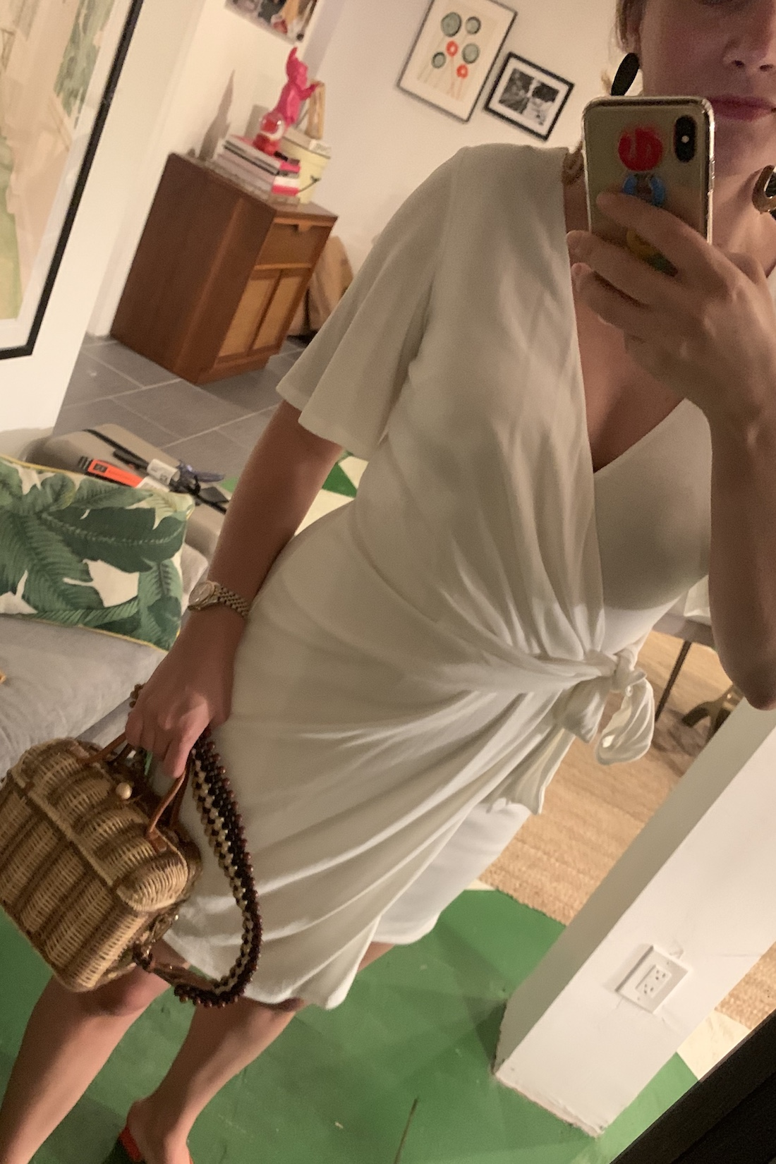 A white wrap dress and structured bag