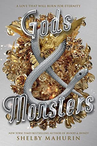 This is the book cover of Gods and Monsters. The book is silver and like the Blood and Honey cover, there are gold decorations behind the writing and there is a silver snake on top. The book title is writing in silver.