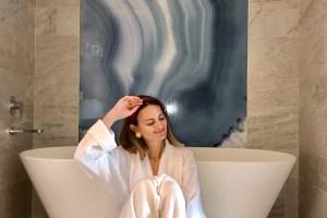 Women in spa wearing white robe