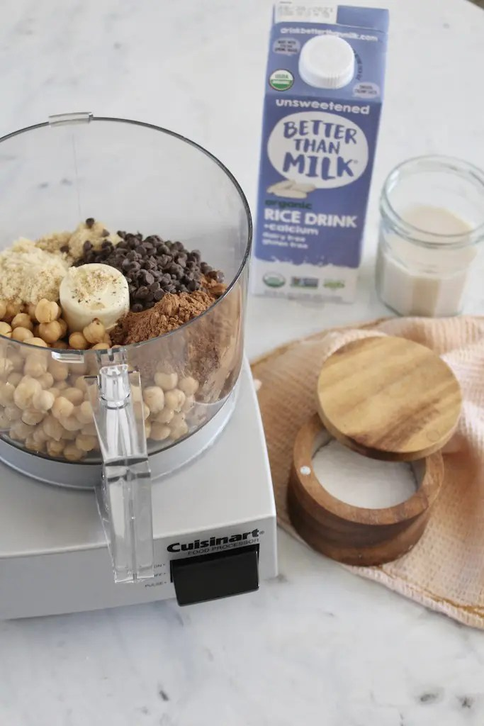 Chocolate chick pea dessert hummus in a cuisinart mixer with Better Than Milk Rice Drink with Calcium