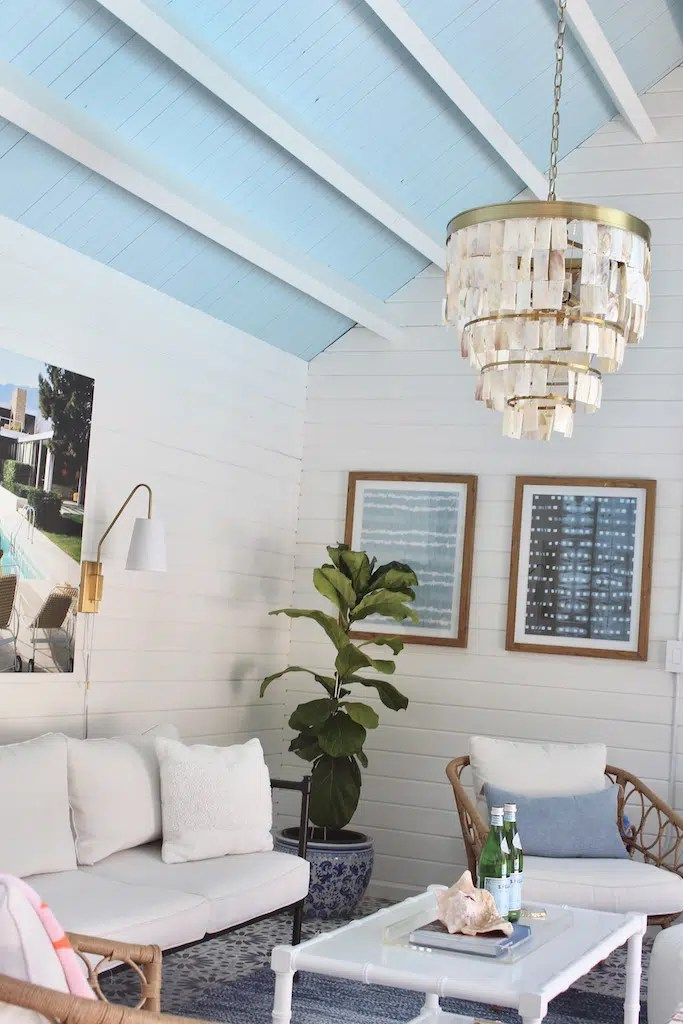 DIY pool house with blue and white decor