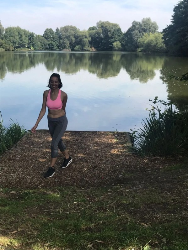 Fitness girl by river.