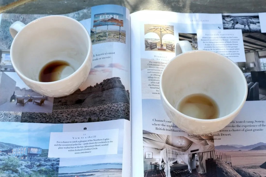 two empty coffee cups on a magazine - blog post on feeling better about yourself