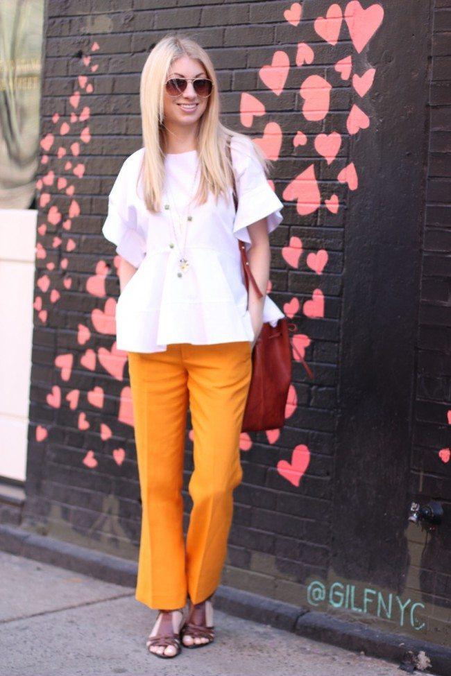 Architectural white top, mustard yellow pants, mansur gavriel camel bag