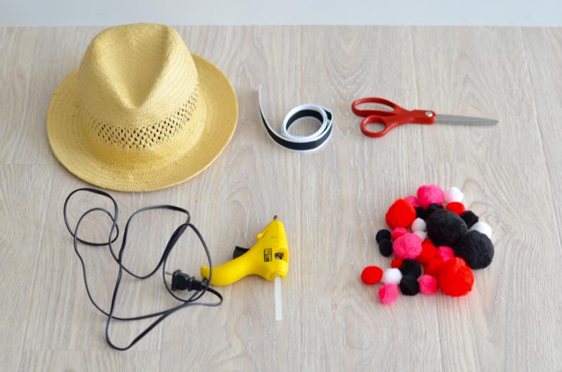 DIY pom pom straw hat // thestylesafari.com