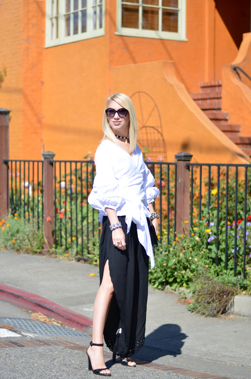 off the shoulder white storets blouse, black open leg cotton pants