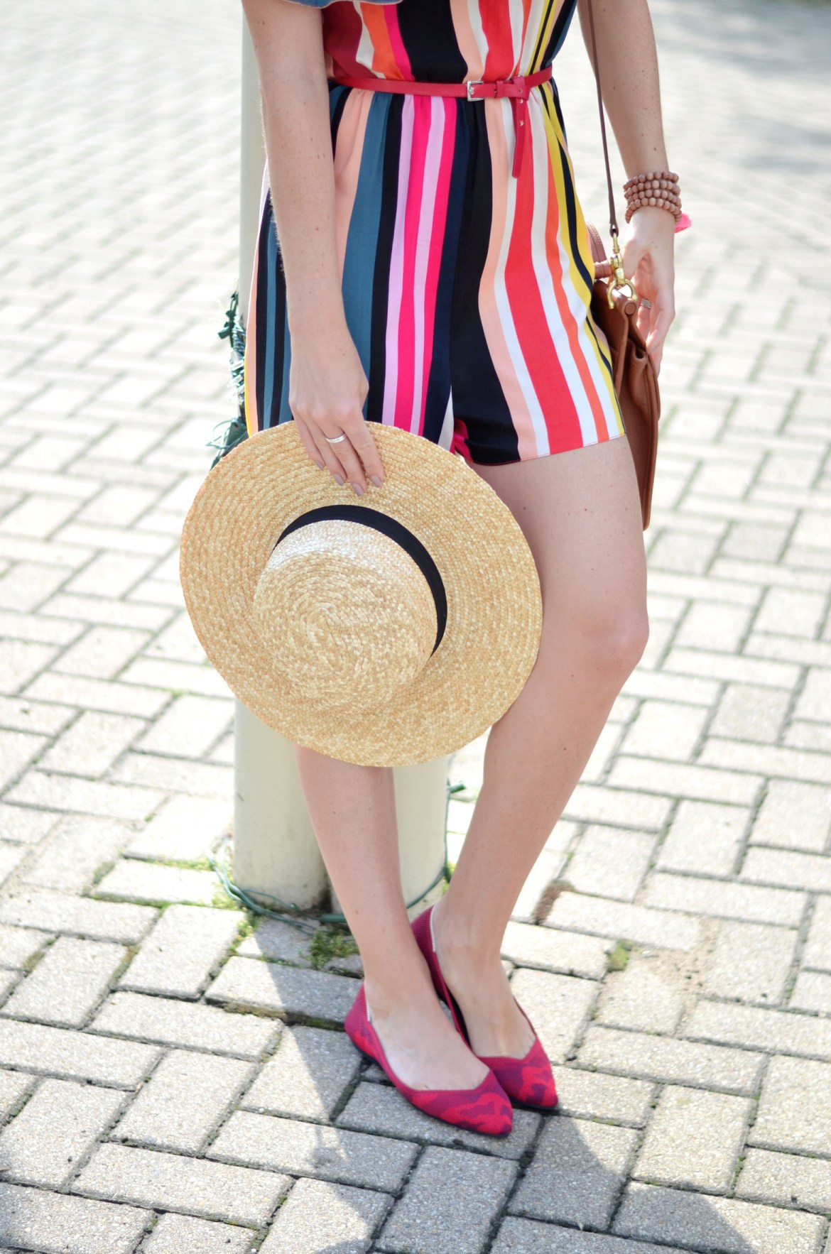 stefanie schoen of the style safari wears red camo seemless knit Rothys flats and Striped ASOS romper