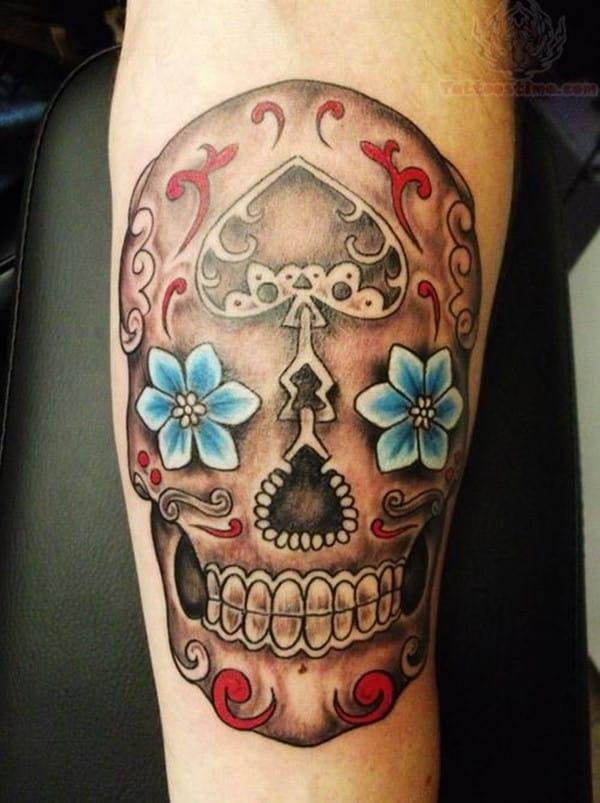 sugar-skull-blue-flower-eyes-tattoo