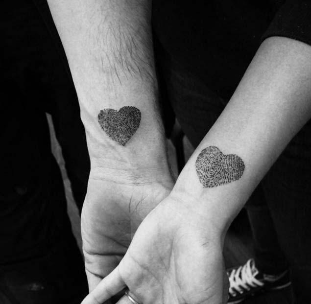Heart-Shaped Finger Print Tattoos by Ugnius Bružinskas
