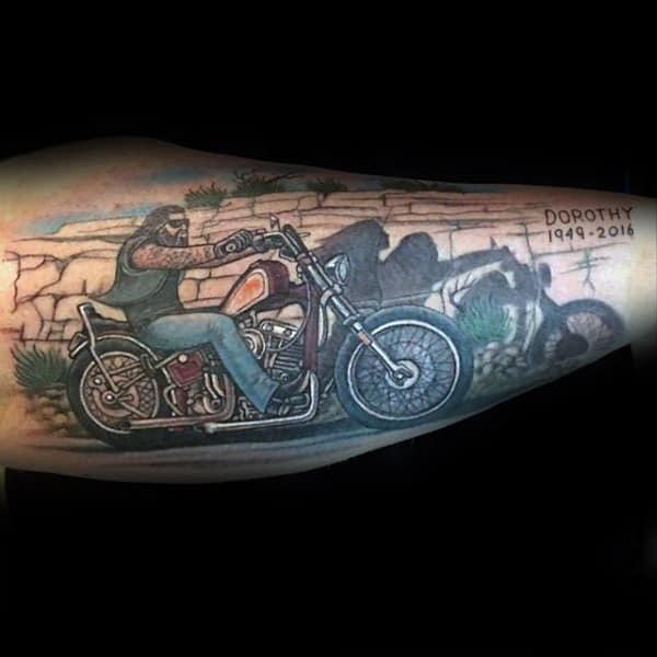 forearm motorbike tattoo