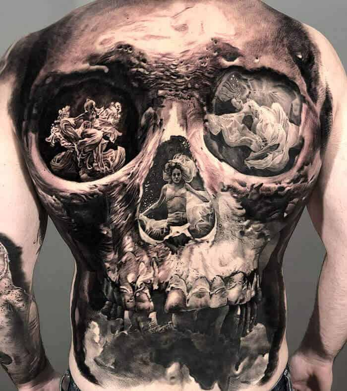 surrealism tattoo on back