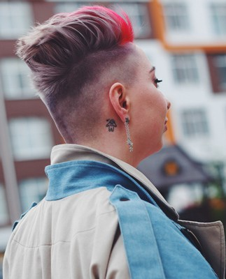 woman with tattoo behind ear