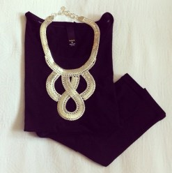 Plain black top dressed up with a statement necklace
