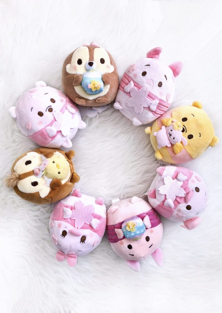 Disney Ufufy Plush pictured in a circle with limited edition sakura edition from Japan