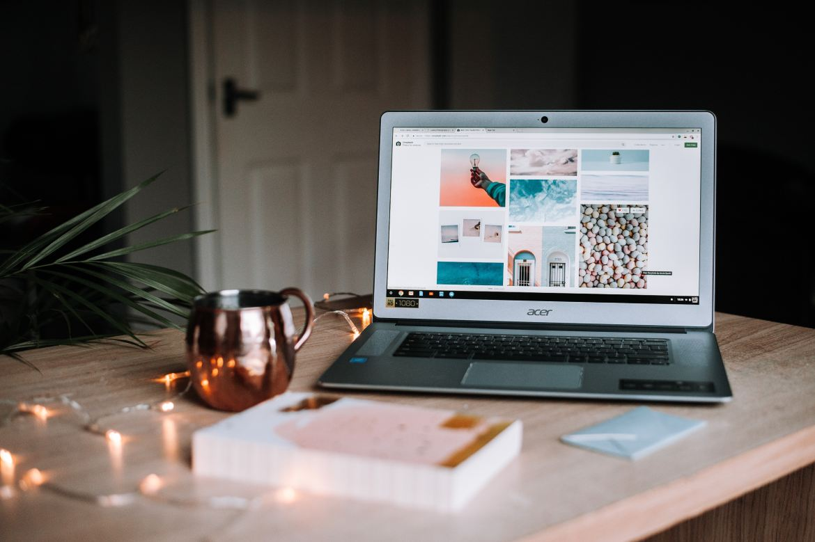 How to Become a Fashion Designer Open Laptop on Bedroom Desk