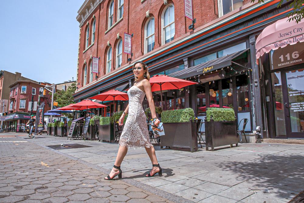 kasey ma of thestylewright walks across jersey city in an eliza j dress