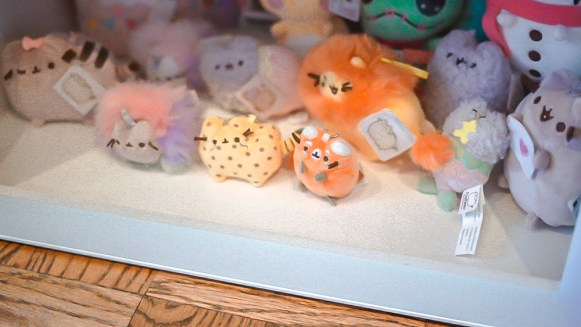 Pusheen plush collection on shelves