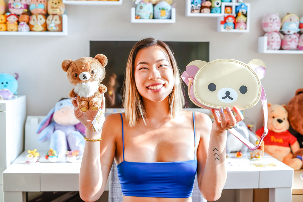 kasey ma of the stylewright holding chairoigokuma plush and korilakkuma bag