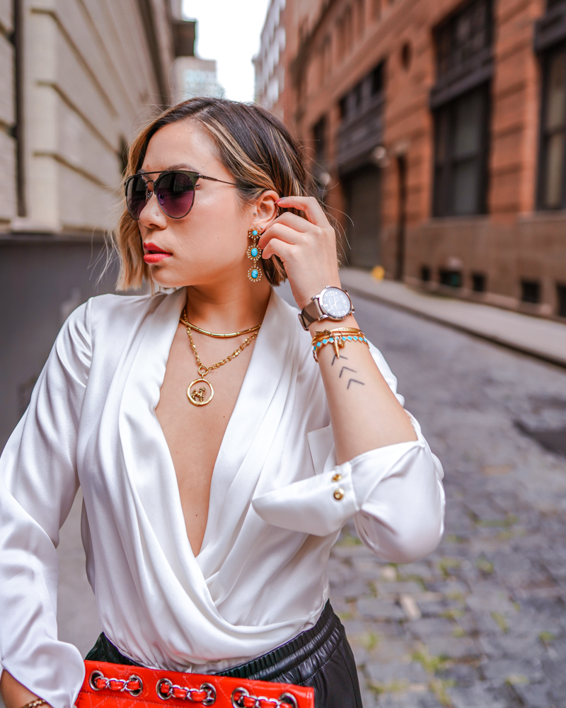 Kasey Ma showing off jewelry for New York Fashion Week