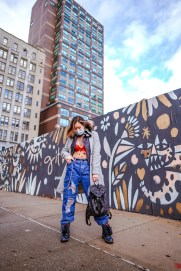 Kasey Ma wearing blue ripped jeans and a sheer mesh top from SHein outside of Spring Studios before NYFW 2020