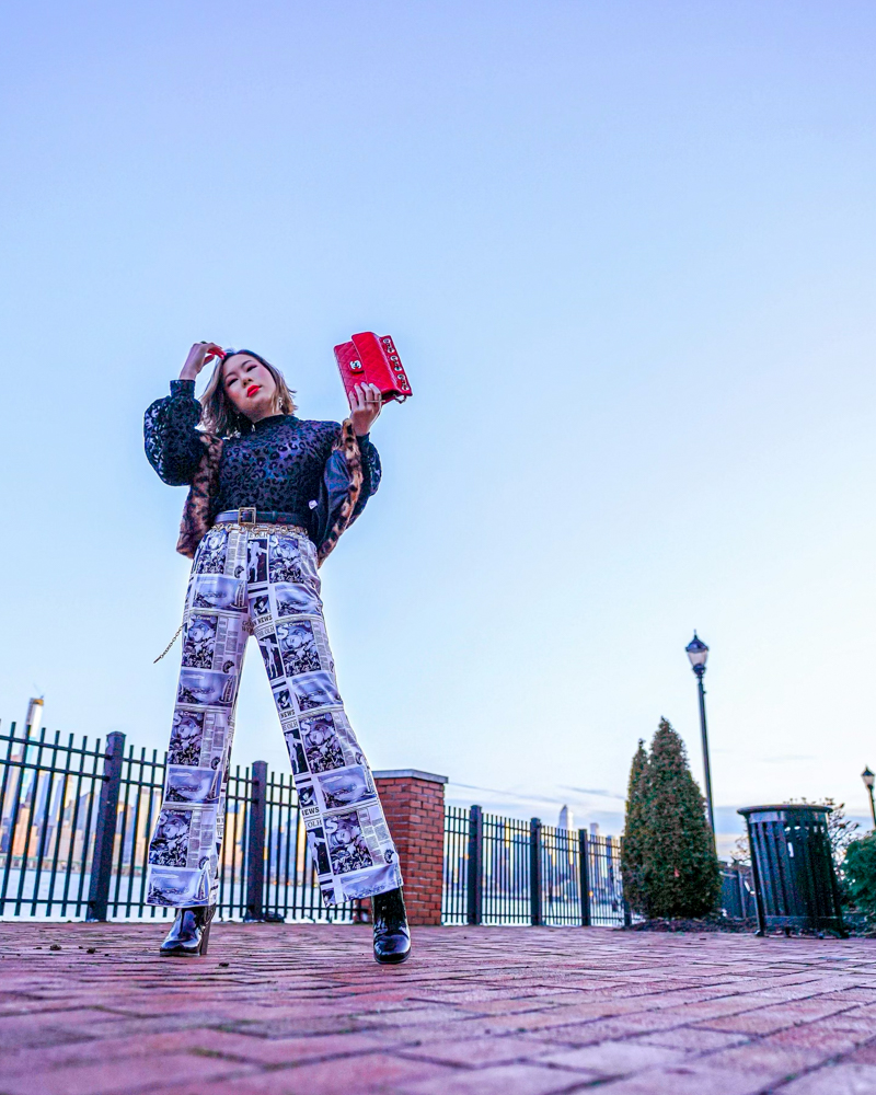 Kasey Ma of TheStyleWright Wearing Shein newspaper pants, red Chanel bag, sheer leopard top and vest for for NYFW 2020