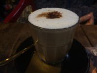 My friend's coffee, doesn't it look good? Coconut on top.