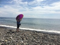Megan in the sun at the beach