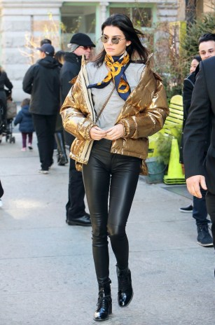 Gold metallic puffer jacket by Ports 1961 over a gray tee and black leather leggings, plus lace-up ankle boots, Krewe sunglasses and a Chanel silk neck scarf
